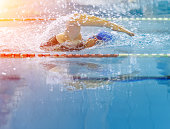Swimmer in a race with water reflection and copy space