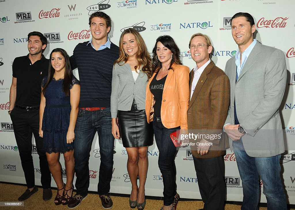 Swimmer Rebecca Soni, figure skater Evan Lysacek, gymnast Aly Reisman, swimmer Nathan Adrian, swimmer Natalie Coughlin, gymnast Nadia Comaneci, gymnast Bar Conner and swimmer Lenny Krayzelburg attend the Gold Meets Gold Event, held at the Equinox Sports Club Flagship West Los Angeles location on Saturday, January 12, 2013 in Los Angeles, California.