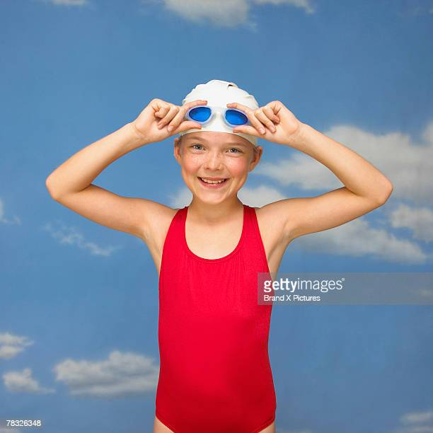 Swimmer removing goggles