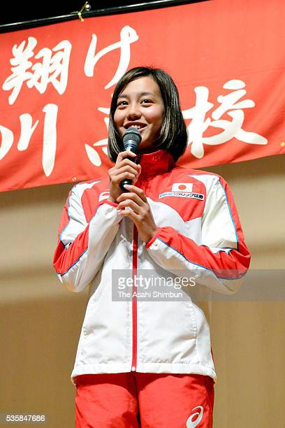 Swimmer Runa Imai speaks during the sending off ceremony for the Rio de Janeiro Olympic Games at Toyokawa High School on May 30 2016 in Toyokawa...