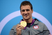 US swimmer Ryan Lochte poses on the podium with the gold medal after winning the men's 400m individual medley swimming event at the London 2012...