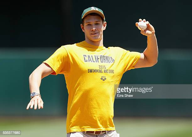 Swimmer Ryan Murphy throws out the first pitch before the Oakland Athletics game against the Detroit Tigers at the Coliseum on May 29 2016 in Oakland...