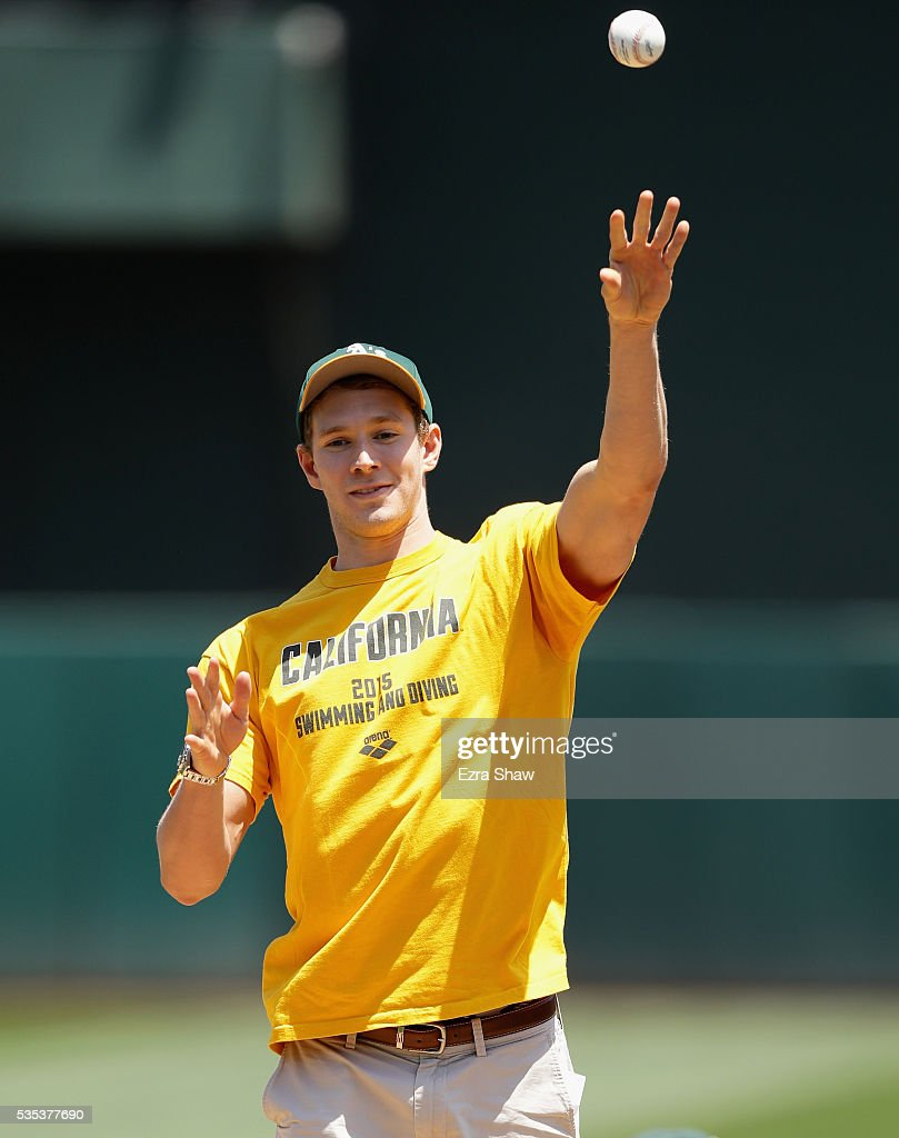 Swimmer Ryan Murphy throws out the first pitch before the Oakland Athletics game against the Detroit Tigers at the Coliseum on May 29, 2016 in Oakland, California.