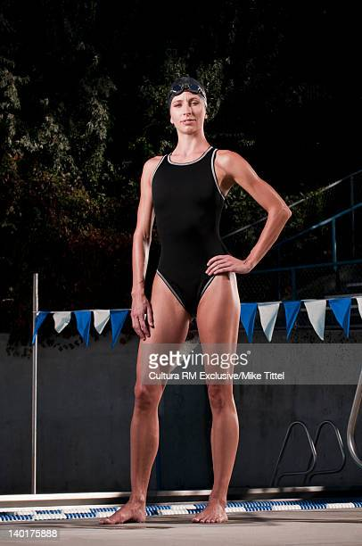 Swimmer standing at edge of pool
