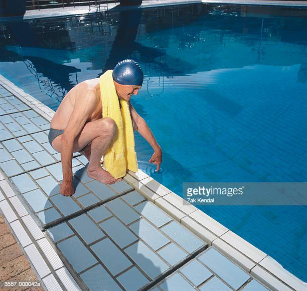 Swimmer Testing Water in Pool