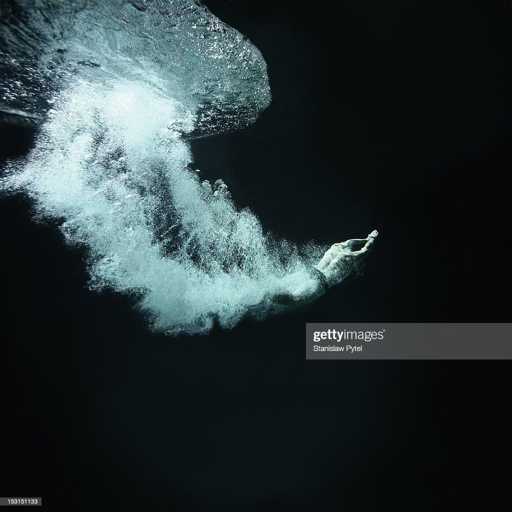 Swimmer underwater after jump