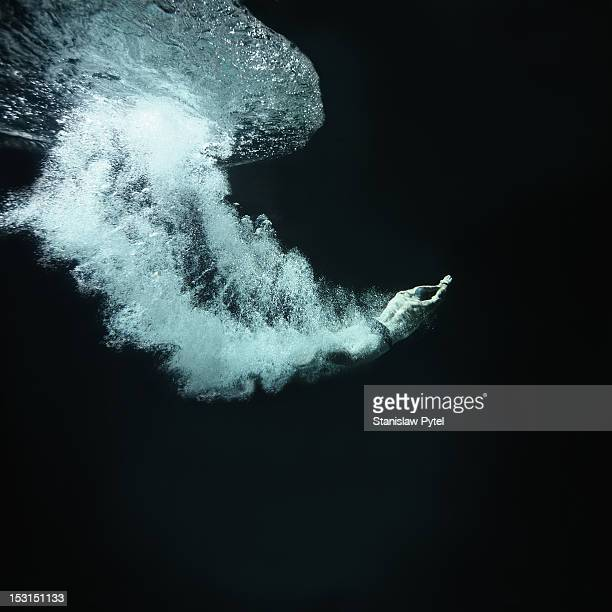 Swimmer underwater after jump