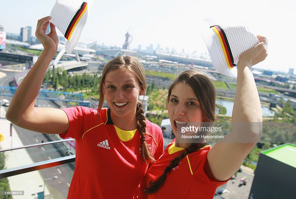 Swimmers Alexandra Wenk and Annika Bruhn of Germany enjoy the atmosphere in the Olympic Village ahead of the London 2012 Olympics at the Olympic Park...