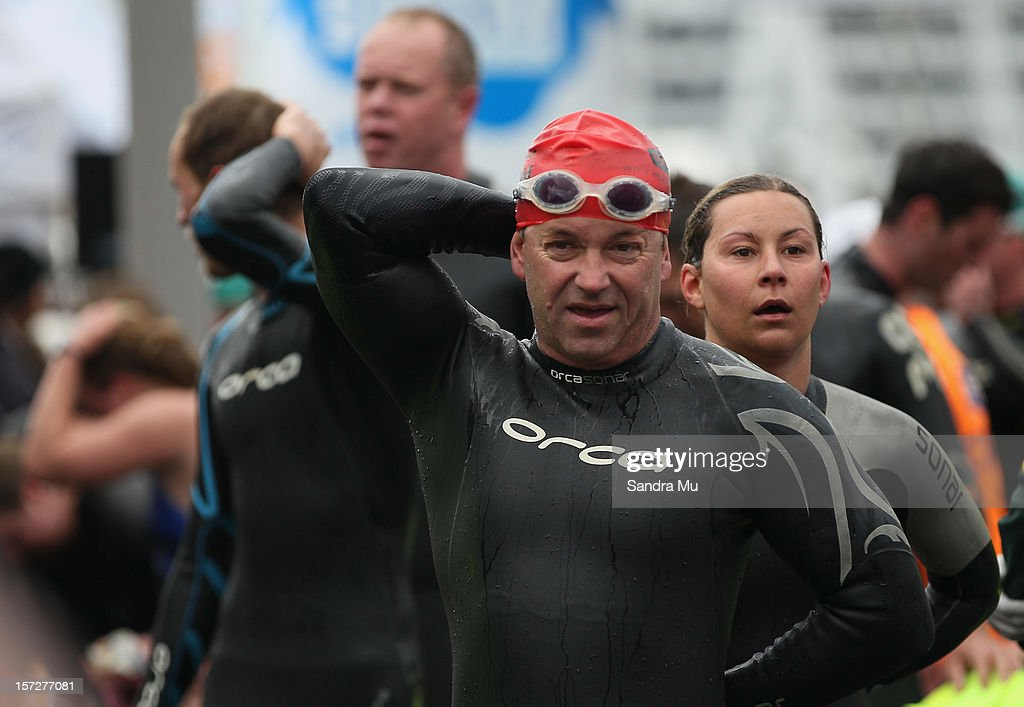 Swimmers are seen as they cross the finish line during the Auckland Harbour Crossing ocean swim event at the Viaduct Harbour on December 2, 2012 in Auckland, New Zealand.