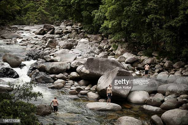 Swimmers are seen in the Mossman river which flows through world heritage listed daintree rainforest on November 15 2012 in Mossman Gorge Australia...