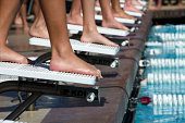 Swimmers at starting blocks before race