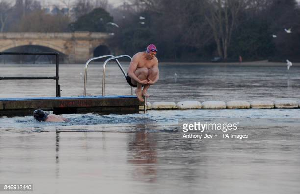 Swimmers brave the early morning cold weather to swim in the Serpentine in Hyde Park London as parts of Britain were placed on amber alert today as...