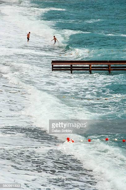 Swimmers brave the rough seas in Positano