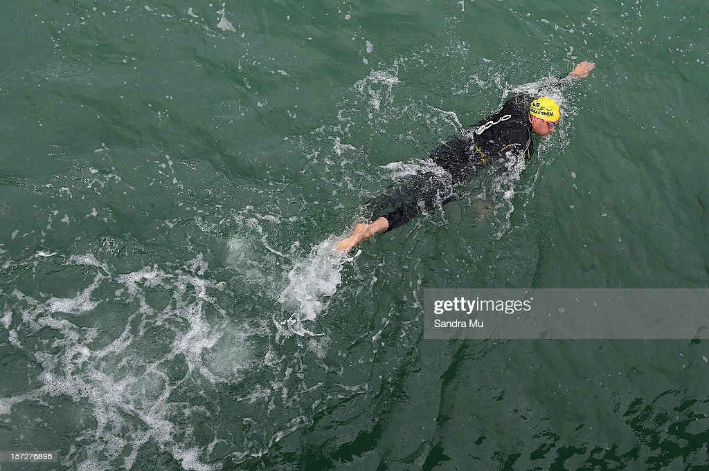 Swimmers compete in the Auckland Harbour Crossing ocean swim event at the Viaduct Harbour on December 2, 2012 in Auckland, New Zealand.
