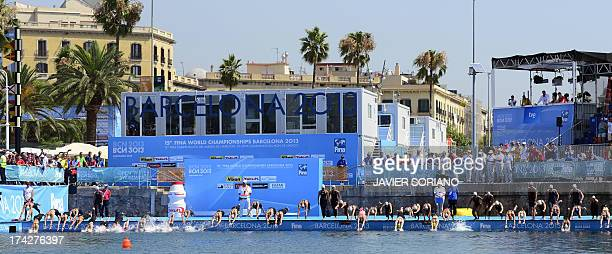 Swimmers compete in the women's 10km open water swimming event in the FINA World Championships on July 23 2013 in Port Vell in Barcelona AFP PHOTO /...