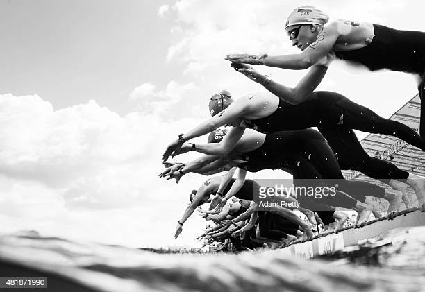 Swimmers dive in at the start of the Women's 5km Open Water Swimming on day one of the 16th FINA World Championships at the Kazanka River on July 25...