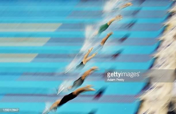 Swimmers dive in the water at the start of heat four of the Women's 50m Butterfly during Day Fourteen of the 14th FINA World Championships at the...