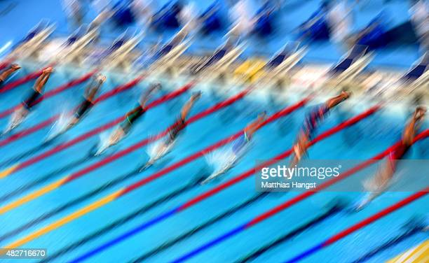 Swimmers dive in the Women's 100m Butterfly Heat 6 on day nine of the 16th FINA World Championships at the Kazan Arena on August 2 2015 in Kazan...