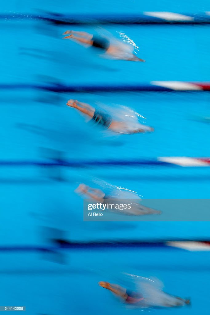 Swimmers dive in to compete in a heat for the Men's 50 Meter Freestyle during Day Six of the 2016 U.S. Olympic Team Swimming Trials at CenturyLink Center on July 1, 2016 in Omaha, Nebraska.