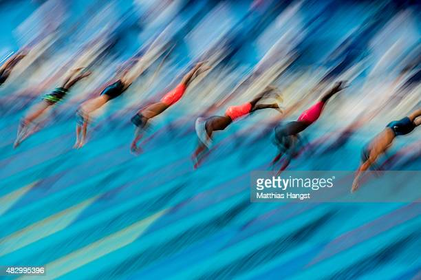 Swimmers dive in to start the Men's 100m Freestyle heat 5 on day twelve of the 16th FINA World Championships at the Kazan Arena on August 5 2015 in...