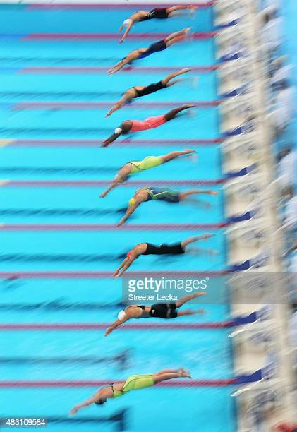 Swimmers dive in to start the Women's 100m Freestyle heats on day thirteen of the 16th FINA World Championships at the Kazan Arena on August 6 2015...