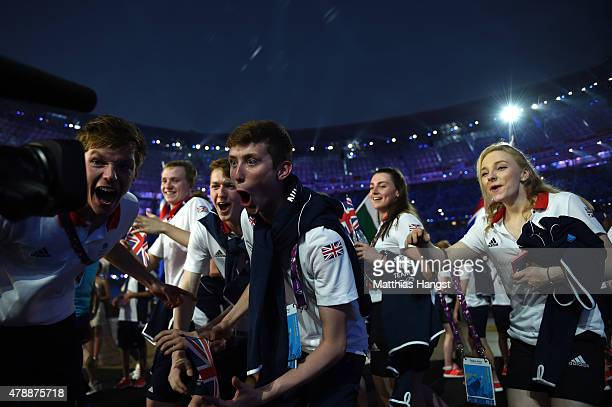 Swimmers Duncan Scott and Cameron Kurle of Great Britain celebrate as they enter the stadium during the Closing Ceremony for the Baku 2015 European...