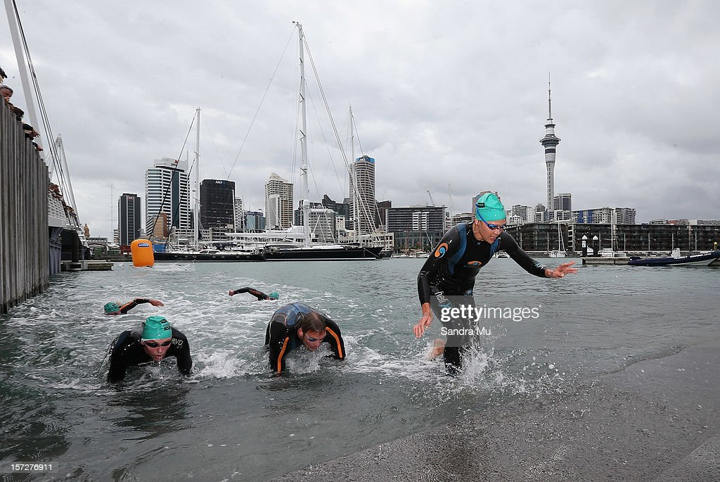 Swimmers emerge from the water during the Auckland Harbour Crossing ocean swim event at the Viaduct Harbour on December 2, 2012 in Auckland, New Zealand.