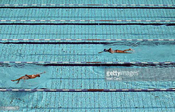 Swimmers enjoy one of the outside swimming pools which form part of the Olympic Aquatic Centre at the Athens Olympic Sports Complex is seen on June 1...