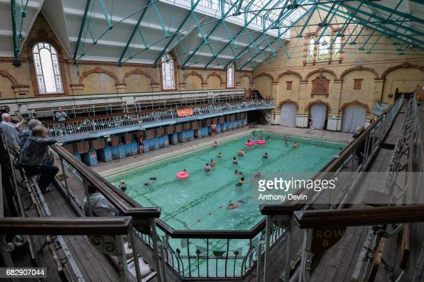 Swimmers enjoy the Men's First Class pool at Victoria Baths which are open today for the first time in 20 years for a one off public swimming event...