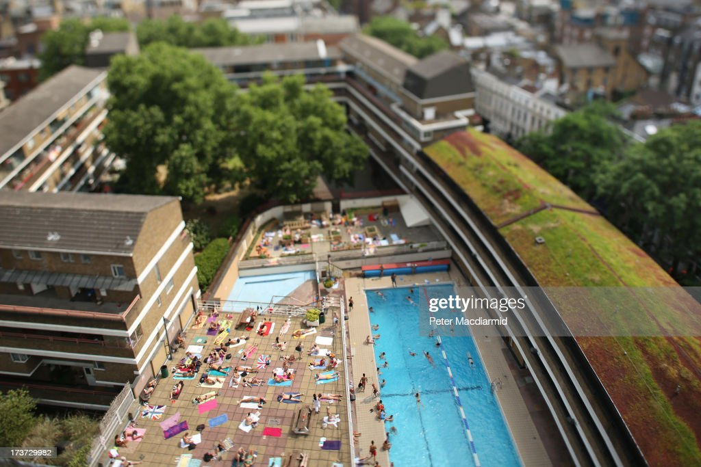 . Swimmers enjoy the sunshine at an outdoor pool in central London on July 17, 2013 in England. The United Kingdom is experiencing heatwave conditions for a second week.
