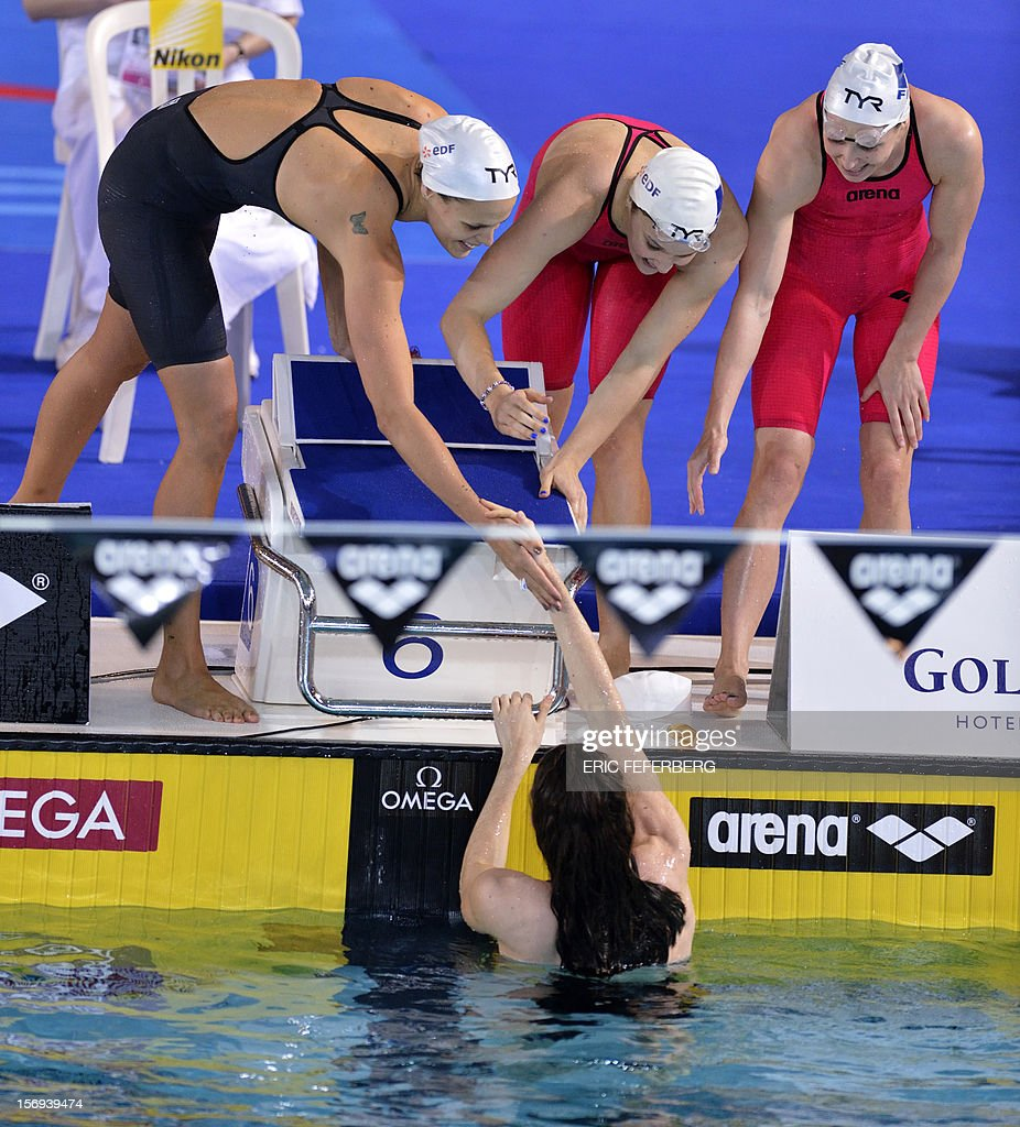 Swimmers from France's team, Laure Manaudou (Top L), Melanie Henique (Top C), Fanny Babou (Top R), and Anna Satamans (Bottom), react at the end of the women's short course 4X50m medley final at the European Swimming Championships on November 25, 2012, in Chartres. The French team came in third.