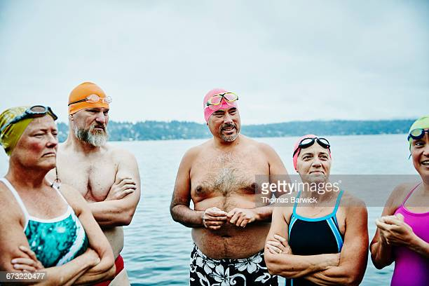 Swimmers in discussion before open water swim