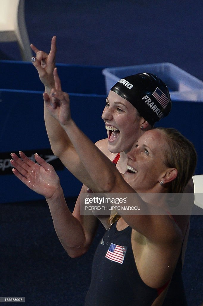 US swimmers Jessica Hardy (R) and Missy Franklin celebrate after winning the final of the women's 4x100-metre medley relay swimming event in the FINA World Championships at Palau Sant Jordi in Barcelona on August 4, 2013.