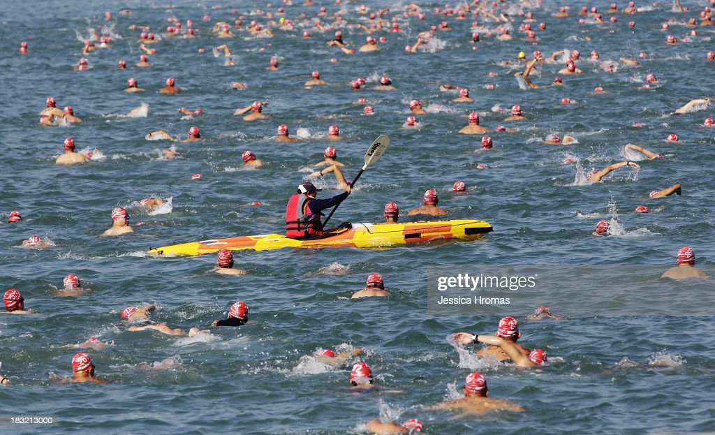 Swimmers make their way across Victoria Harbour during the New World Harbour Race on October 6, 2013 in Hong Kong. The 1.5 kilometer open water swimming race starts at Lei Yue Mun, Kowloon and finishes at Quarry Bay Park, Hong Kong Island, two thousand competitors are competing.