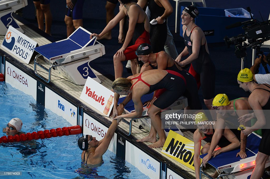 US swimmers Megan Romano (bottom), Jessica Hardy, Dana Vollmer and Missy Franklin celebrate next to Australia's Emily Seebohn (R), Alicia Coutts (2nd R) and Sally Foster (3rd R) after winning the final of the women's 4x100-metre medley relay swimming event in the FINA World Championships at Palau Sant Jordi in Barcelona on August 4, 2013.