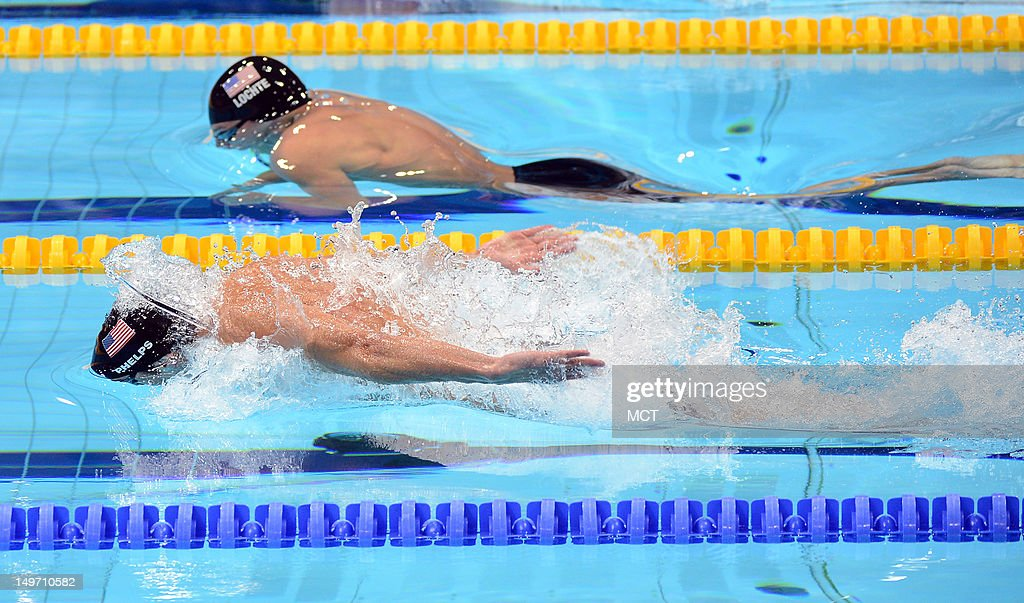 USA swimmers Michael Phelps and Ryan Lochte break from the water at the start of the butterfly stroke in the men's 200m individual medley at the...