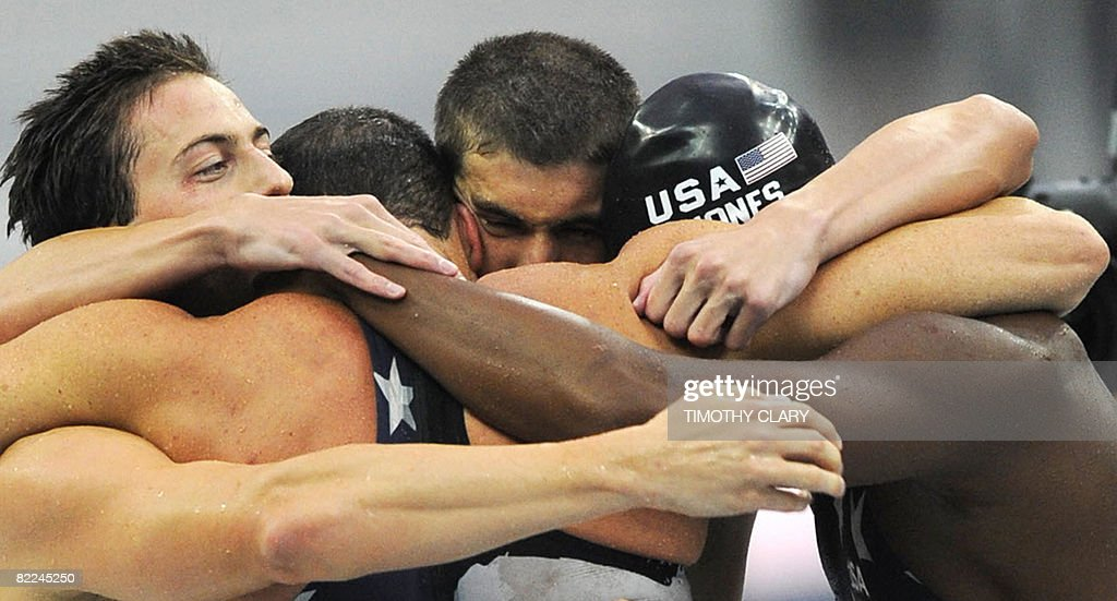 US swimmers <a gi-track='captionPersonalityLinkClicked' href=/galleries/search?phrase=Michael+Phelps&family=editorial&specificpeople=162698 ng-click='$event.stopPropagation()'>Michael Phelps</a> (2nd R), Jason Lezak (2nd L) Garrett Weber-Gale (L) and <a gi-track='captionPersonalityLinkClicked' href=/galleries/search?phrase=Cullen+Jones&family=editorial&specificpeople=1047215 ng-click='$event.stopPropagation()'>Cullen Jones</a> (R) react after winning the men's 4X100m freestyle relay swimming final at the National Aquatics Center in the 2008 Beijing Olympic Games on August 11, 2008. The US broke the world record in the men's 4x100-metres freestyle relay, winning gold in 3min 08.24 to keep <a gi-track='captionPersonalityLinkClicked' href=/galleries/search?phrase=Michael+Phelps&family=editorial&specificpeople=162698 ng-click='$event.stopPropagation()'>Michael Phelps</a>'s dream of eight Olympic gold medals alive. RECROPPED