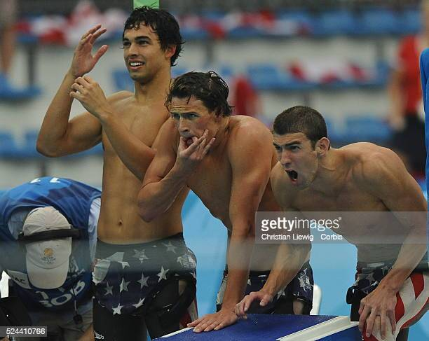 US swimmers Michael Phelps Ryan Lochte and Ricky Berens cheer on anchor Peter Vanderkaay during the men's 4x200m freestyle relay at the Beijing 2008...