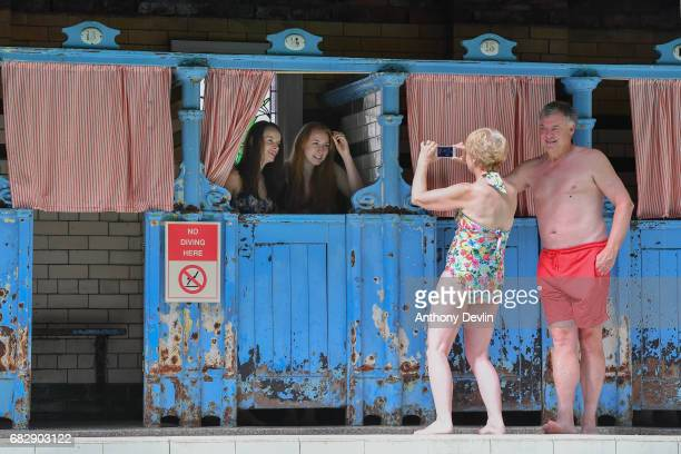 Swimmers Nicola Pearson and Linzi Wright pose for a photograph before entering the Men's First Class pool at Victoria Baths which are open today for...