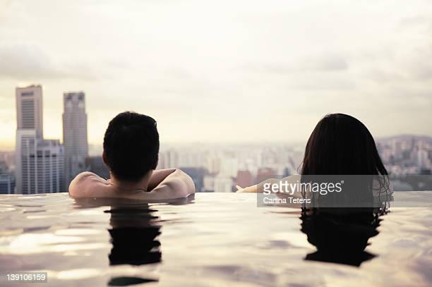 Swimmers overlooking city skyline