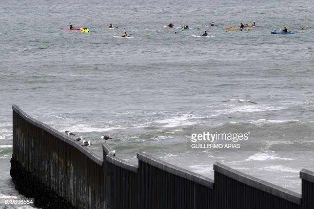 TOPSHOT Swimmers participating in the PanAmerican Colibri Crossing arrive at the beach in Playas de Tijuana Mexico on May 5 after swimming across the...