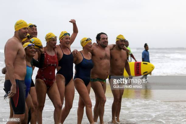 Swimmers participating in the PanAmerican Colibri Crossing celebrate upon arrival to the beach in Playas de Tijuana Mexico on May 5 after swimming...