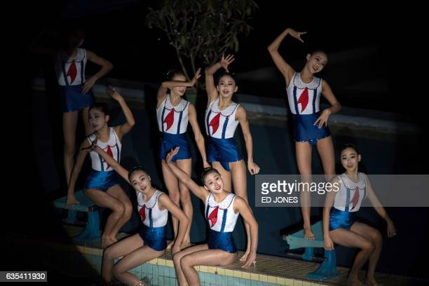 TOPSHOT Swimmers perform in a synchronized swimming gala event in Pyongyang on February 15 2017 The gala was part of a series of events being held to...