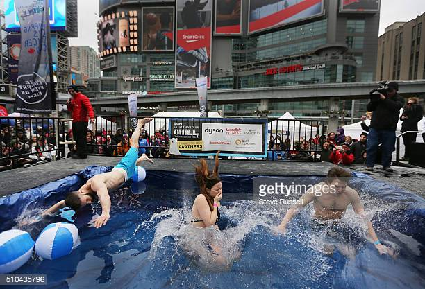 Swimmers plunge into a four foot deep pool for The Sears Great Canadian Chill in Toronto is an urban Polar Bear Dip to raise money to stop children's...