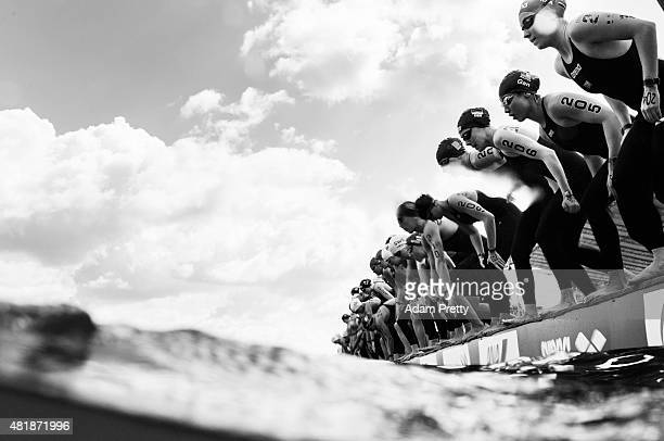 Swimmers prepare to dive in at the start of the Women's 5km Open Water Swimming on day one of the 16th FINA World Championships at the Kazanka River...