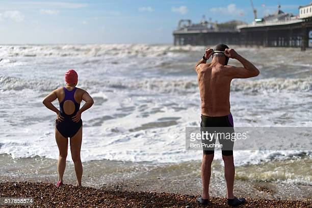 Swimmers prepare to swim in the sea on Brighton Beach on March 28 2016 in Brighton England Yesterday the Met Office issued an amber warning for winds...