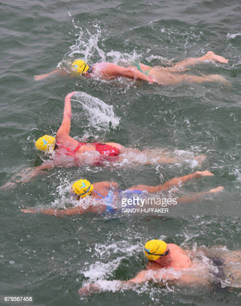 Swimmers prepare to take off from the Imperial beach Pier for a 10 kilometer swim down across the United StatesMexico border to raise awareness for...