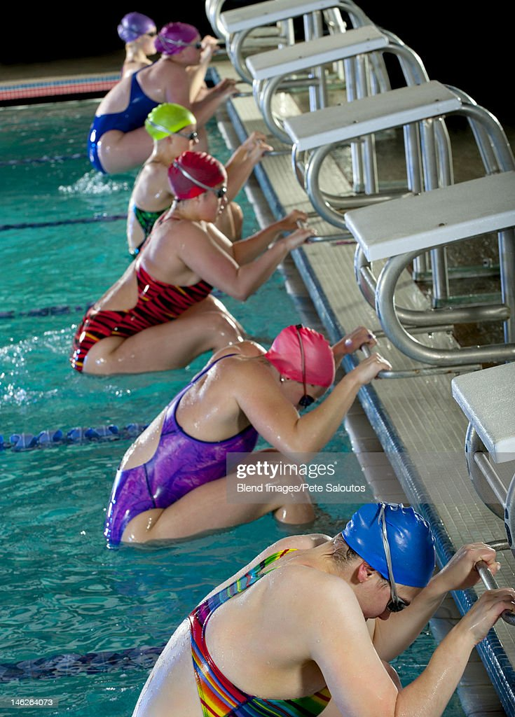 Swimmers preparing to start race : Stock Photo