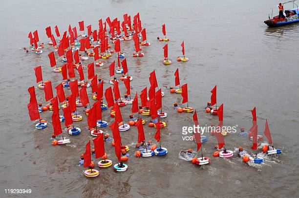 Swimmers swim across the Yangtze River during the 38th International Yangtze River Crossing Festival on July 16 2011 in Wuhan Hubei Province of China...