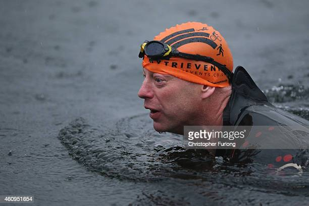 Swimmers take a dip in the icy waters of Lake Windermere during a charity swim to welcome in the New Year at Lake Windermere on January 1 2015 in...